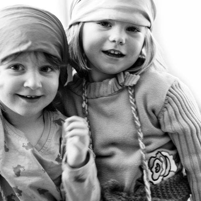 Two kindergarteners playing dress up at the Maine Coast Waldorf School