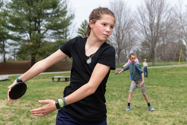 Girl trains with discus throw for 5th grade olympic games
